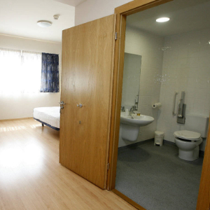 Adapted room with accessible toilet
