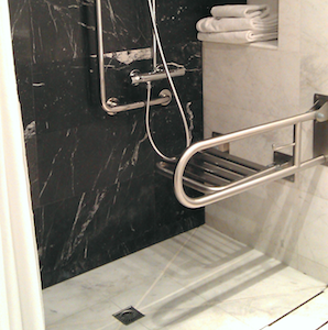 Photo of accessible shower including chair in hotel room