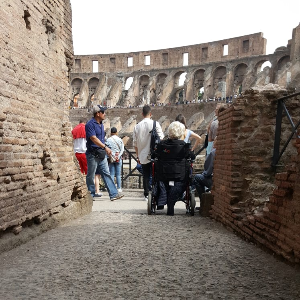 Woman in wheelchair in Colosseum